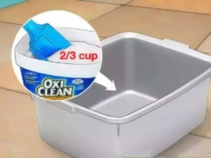 Nước nóng, baking soda và nước dấm vào trong máy giặt